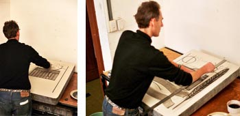 photos of simon ogden drawing his stone